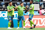 Seattle Sounders forward Raul Ruidiaz (9) celebrates his goal the first half of round one of an MLS Cup playoff soccer game against FC Dallas, Saturday, Oct. 19, 2019 in Seattle. (Andy Bao/The Seattle Times via AP)