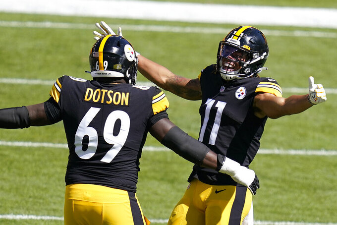 Pittsburgh Steelers wide receiver Chase Claypool (11) celebrates after scoring on an an 84-yard play with Kevin Dotson during the first half of an NFL football game against the Denver Broncos, Sunday, Sept. 20, 2020, in Pittsburgh. (AP Photo/Keith Srakocic)