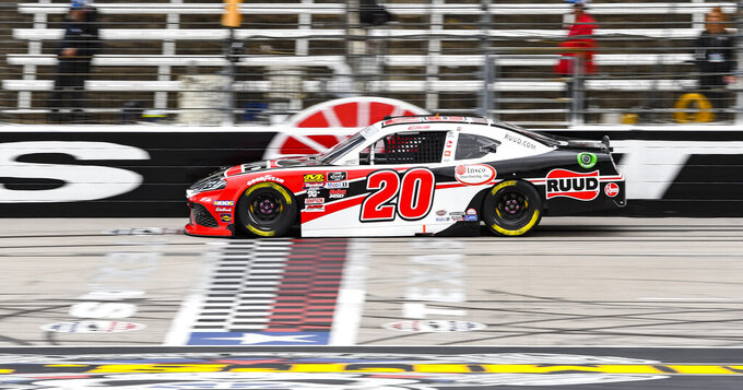Driver Christopher Bell crosses the finish line to win the pole position during qualifying for a NASCAR auto race at Texas Motor Speedway, Saturday, March 30, 2019, in Fort Worth, Texas. (AP Photo/Larry Papke)