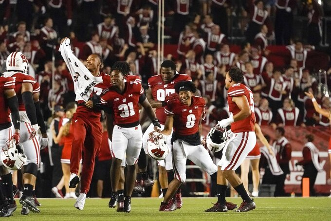 """Wisconsin players """"Jump Around"""" during the second half of an NCAA college football game against Eastern Michigan Saturday, Sept. 11, 2021, in Madison, Wis. (AP Photo/Morry Gash)"""