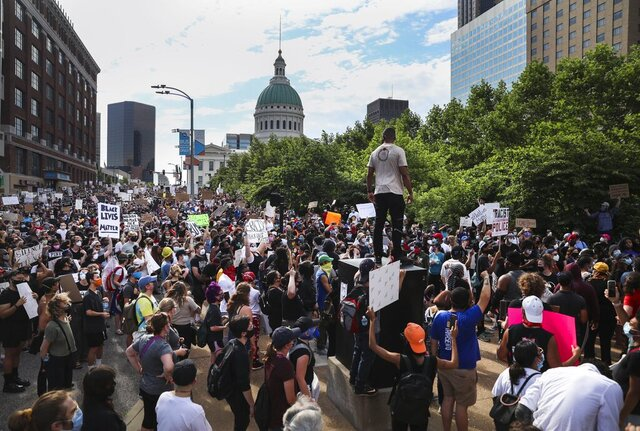 Protesters fill Market Street near the Gateway Arch grounds during an event organized by ExpectUS in St. Louis on Monday, June 1, 2020. Protesters were demonstrating against the death of George Floyd, who died May 25 after being detained by Minneapolis police. (Colter Peterson/St. Louis Post-Dispatch via AP)