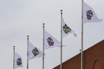 Final Four flags fly over the national office of the NCAA in Indianapolis, Thursday, March 12, 2020. The NCAA canceled the men's and women's Division I basketball tournaments amid coronavirus fears on Thursday, (AP Photo/Michael Conroy)