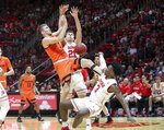 Oregon State forward Tres Tinkle (3) is fouled as Utah forwards Donnie Tillman, right, and Riley Battin (21) defend during the first half of an NCAA college basketball game Saturday, Feb. 2, 2019, in Salt Lake City. (AP Photo/Chris Nicoll)