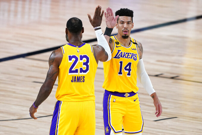 Los Angeles Lakers' LeBron James (23) and Danny Green (14) celebrate after a play against the Portland Trail Blazers during the first half of an NBA basketball first round playoff game Saturday, Aug. 29, 2020, in Lake Buena Vista, Fla. (AP Photo/Ashley Landis)