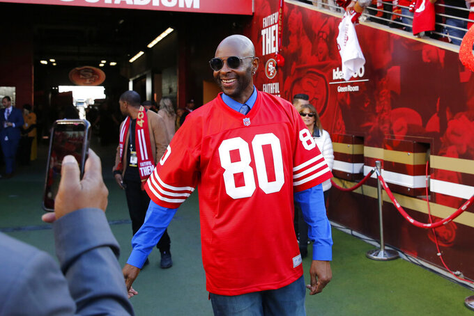 FILE - In this Dec. 15, 2019, file photo, Jerry Rice smiles an NFL football game between the San Francisco 49ers and the Atlanta Falcons in Santa Clara, Calif. Rice's son, Brenden, is following in his father's footsteps by playing as a wide receiver for the Colorado Buffaloes in this coronavirus-shortened season. (AP Photo/John Hefti, File)