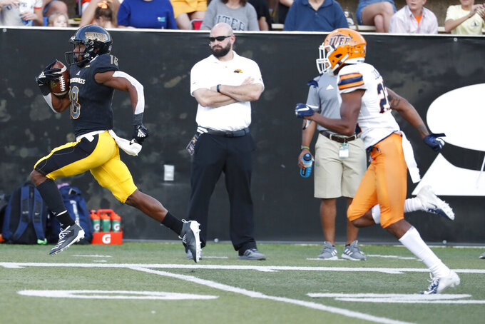Southern Mississippi wide receiver De'Michael Harris (18) runs away from a UTEP defender on his way to a 74-yard touchdown pass reception during the first half of their NCAA college football game in Hattiesburg, Miss., Saturday, Sept. 28, 2019. (AP Photo/Rogelio V. Solis)