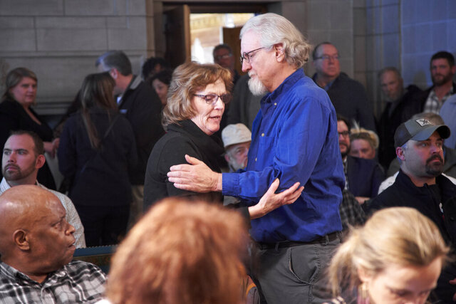 Paulette Neemann, left, and Dave Ellis, relatives of murdered victims of Charles Starkweather, hug in Lincoln, Neb., Tuesday, Feb. 18, 2020, before a hearing of he Nebraska Board of Pardons to consider a request for clemency from Caril Ann Clair, the 76-year-old former girlfriend of Charles Starkweather, who went on an infamous killing spree in Nebraska and Wyoming in the late 1950s. The pardon board voted 3-0 to deny the application from Clair, even though some relatives of Starkweather's victims lobbied in her favor. Ellis and Neemann were against pardoning Clair. (AP Photo/Nati Harnik)