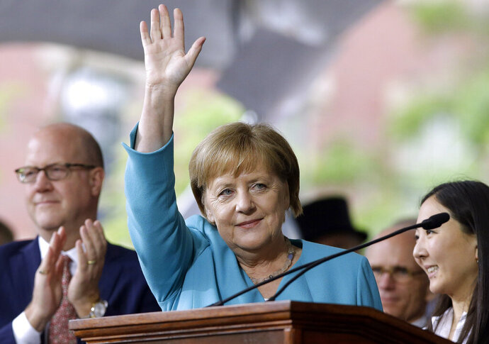 German Chancellor Angela Merkel waves after delivering the commencement address during Harvard University commencement exercises, Thursday, May 30, 2019, on the school's campus, in Cambridge, Mass. (AP Photo/Steven Senne)