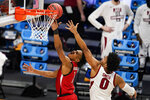 Texas Tech guard Terrence Shannon Jr. (1) shoots in front of Arkansas forward Justin Smith (0) in the first half of a second-round game in the NCAA men's college basketball tournament at Hinkle Fieldhouse in Indianapolis, Sunday, March 21, 2021. (AP Photo/Michael Conroy)