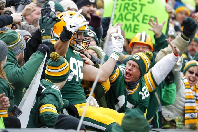 Green Bay Packers' Robert Tonyan celebrates his touchdown catch during the first half of an NFL football game against the Washington Redskins Sunday, Dec. 8, 2019, in Green Bay, Wis. (AP Photo/Matt Ludtke)