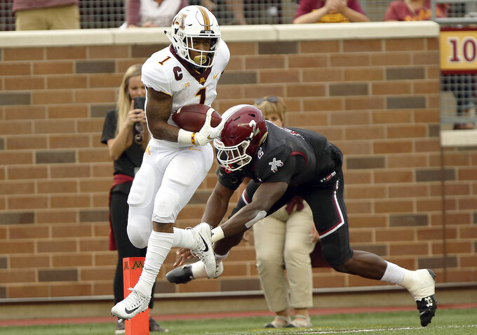 Minnesota running back Rodney Smith (1) breaks the tackle of New Mexico State linebacker Terrill Hanks (2) during the first half an NCAA college football game Thursday, Aug. 30, 2018, in Minneapolis. (AP Photo/Stacy Bengs)