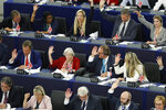 Brexit Party leader Nigel Farage, left middle row, and other Parliament Members vote a resolution for the UK withdrawal from the EU, Wednesday, Sept. 18, 2019 in Strasbourg. Members of the European Parliament discuss the current state of play of the UK's withdrawal from the EU. (AP Photo/Jean-Francois Badias)