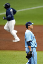 Toronto Blue Jays starting pitcher Hyun-Jin Ryu reacts as Tampa Bay Rays' Mike Zunino runs the bases after Zunino hit a two-run home run during the second inning of Game 2 of an American League wild-card baseball series Wednesday, Sept. 30, 2020, in St. Petersburg, Fla. (AP Photo/Chris O'Meara)