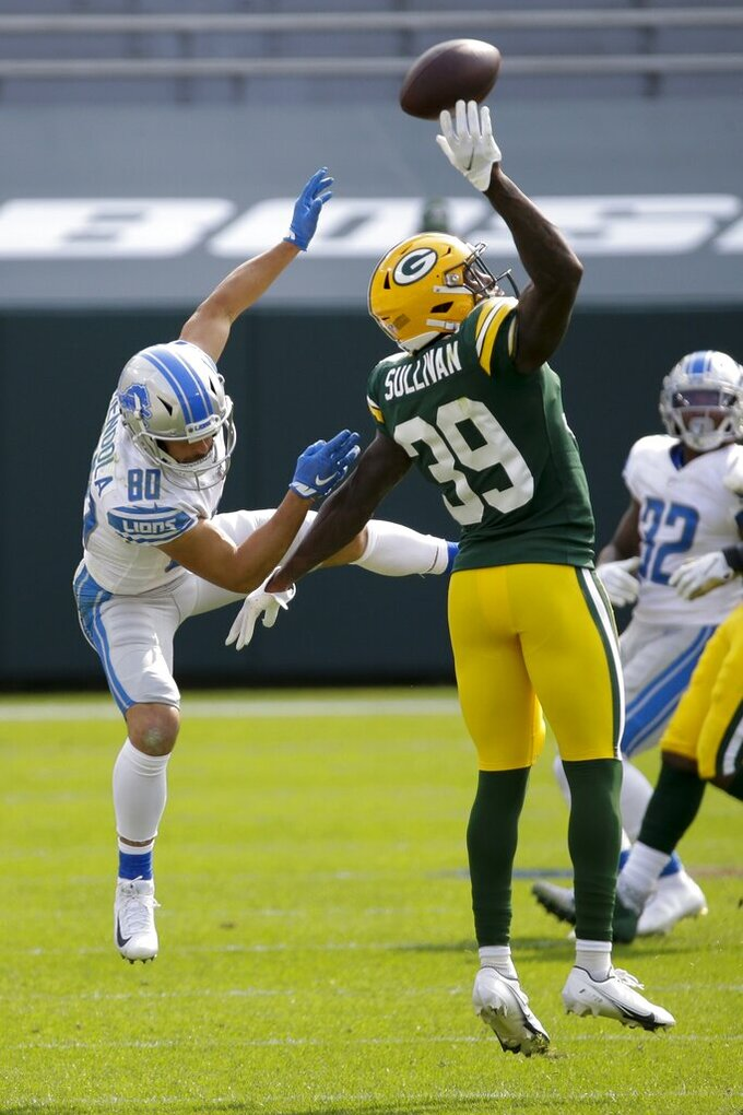 Green Bay Packers' Chandon Sullivan breaks up a pass intended for Detroit Lions' Danny Amendola during the second half of an NFL football game Sunday, Sept. 20, 2020, in Green Bay, Wis. (AP Photo/Mike Roemer)