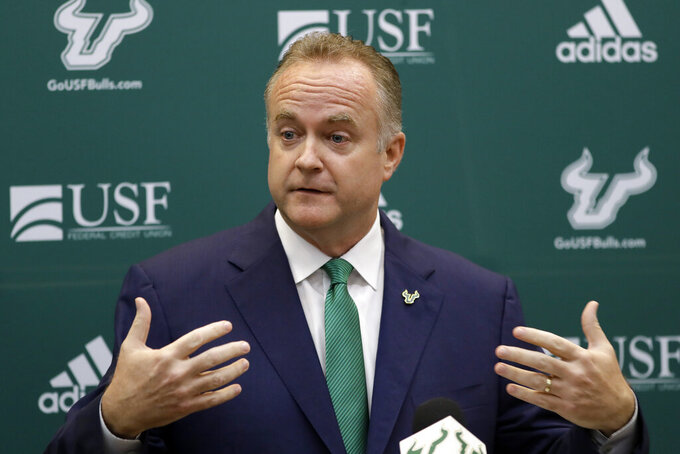 University of South Florida Athletic Director Michael Kelly speaks during a news conference regarding the search for a new head coach of the football team, Monday, Dec. 2, 2019, in Tampa, Fla. The university fired Charlie Strong on Sunday. (AP Photo/Chris O'Meara)