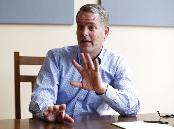 FILE - In this  Jan. 3, 2019 file photo investor and Democratic donor Michael Bills gestures during an interview in Charlottesville, Va.  Since 2018,  Bills has given more than $2 million to dozens of Democratic candidates and political action committees in an effort to weaken the strength of Dominion Energy, long a dominant force in Virginia politics and a major source of corporate campaign donations.  (AP Photo/Steve Helber, File)