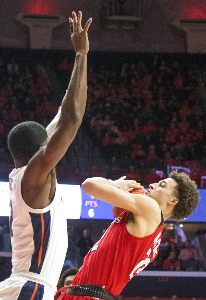 Rutgers guard Montez Mathis, right, goes up against Illinois forward Kipper Nichols, left, during the first half of an NCAA college basketball game in Champaign, Ill., Saturday, Feb. 9, 2019. (AP Photo/Robin Scholz)