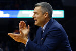 FILE  - Virginia head coach Tony Bennett directs his team during the first half of an NCAA college basketball game against Virginia Tech in Charlottesville, Va., in this Saturday, Jan. 4, 2020, file photo. Virginia will begin the college basketball season at No. 4 in the preseason AP Top 25 poll released Monday, Nov. 9, 2020.(AP Photo/Steve Helber, File)