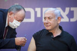 Israeli Prime Minister Minister Benjamin Netanyahu is ready to receive the second COVID-19 vaccine at Sheba Medical Center in Ramat Gan, Israel, on Saturday, Jan. 9, 2021.   (Miriam Elster /Pool Photo via AP)