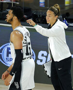 San Antonio Spurs assistant coach Becky Hammon talks with Quinndary Weatherspoon (15) during the second half of an NBA basketball game against the Utah Jazz Friday, Aug. 7, 2020, in Lake Buena Vista, Fla. (Kevin C. Cox/Pool Photo via AP)