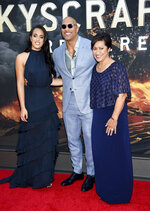 Actor Dwayne Johnson, center, poses with his daughter Simone Johnson, left, and mother Ata Johnson at the