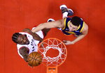 Toronto Raptors forward Kawhi Leonard (2) scores past Golden State Warriors guard Klay Thompson (11) during the second half if Game 5 NBA Finals basketball game in Toronto on Monday, June 10, 2019. (Nathan Denette/The Canadian Press via AP)