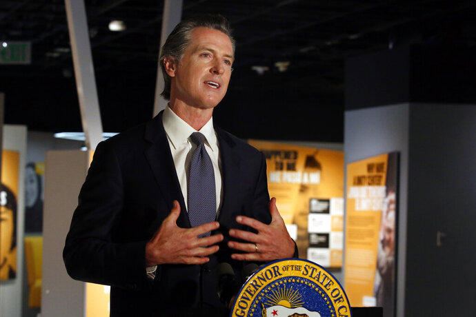 Gov. Gavin Newsom announced that he has ordered the state police training program to stop teaching a neck hold that blocks the flow of blood to the brain, during a news conference in Sacramento, Calif., Friday, June 5, 2020. Speaking from the Unity Center at the California Museum, Newsom said he ordered the state Commission on Peace Officer Standards and Training to stop teaching officers how to use the