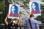 Demonstrators protest Friday, June 5, 2020, near the White House in Washington, over the death of George Floyd, a black man who was in police custody in Minneapolis. Floyd died after being restrained by Minneapolis police officers. (AP Photo/Manuel Balce Ceneta)