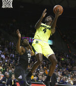 Baylor guard Mario Kegler, right, shoots past TCU center Kevin Samuel, left, in the second half of an NCAA college basketball game, Saturday, Feb. 2, 2019, in Waco, Texas. (Rod Aydelotte/Waco Tribune-Herald via AP)