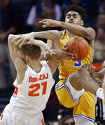 Pittsburgh's Malik Ellison (3) and Syracuse's Marek Dolezaj (21) fight for a rebound during the first half of an NCAA college basketball game in the Atlantic Coast Conference tournament in Charlotte, N.C., Wednesday, March 13, 2019. (AP Photo/Nell Redmond)