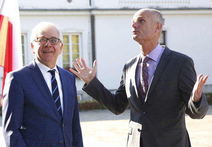 Poland's Foreign Minister Jacek Czaputowicz, left, and his counterpart from The Netherlands, Stef Blok, right, chat prior to talks on bilateral and European Union matters at the Belvedere Palace in Warsaw, Poland, Wednesday, Oct. 10, 2018. (AP Photo/Czarek Sokolowski)