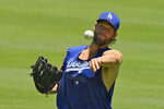 Los Angeles Dodgers starting pitcher Clayton Kershaw warms up during the restart of baseball spring training Saturday, July 4, 2020, in Los Angeles. (AP Photo/Mark J. Terrill)