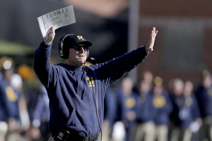 Michigan head coach Jim Harbaugh gestures toward his team during the second half of an NCAA college football game against Maryland, Saturday, Nov. 2, 2019, in College Park, Md. Michigan won 38-7. (AP Photo/Julio Cortez)