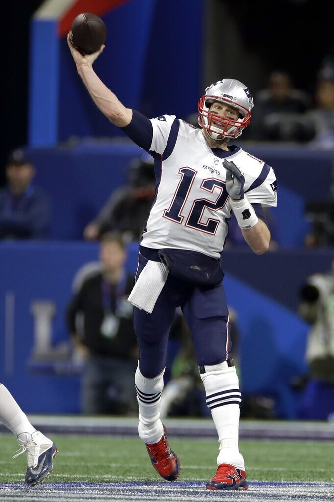 New England Patriots' Tom Brady throws a pass against the Los Angeles Rams during the first half of the NFL Super Bowl 53 football game Sunday, Feb. 3, 2019, in Atlanta. (AP Photo/Carolyn Kaster)