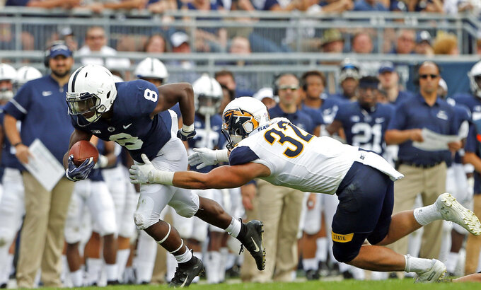 Penn State's Mark Allen (8) runs the ball as Kent State's Dalton Hicks (32) makes the tackle during the second half of an NCAA college football game in State College, Pa., Saturday, Sept. 15, 2018. Penn State won 63-10. (AP Photo/Chris Knight)