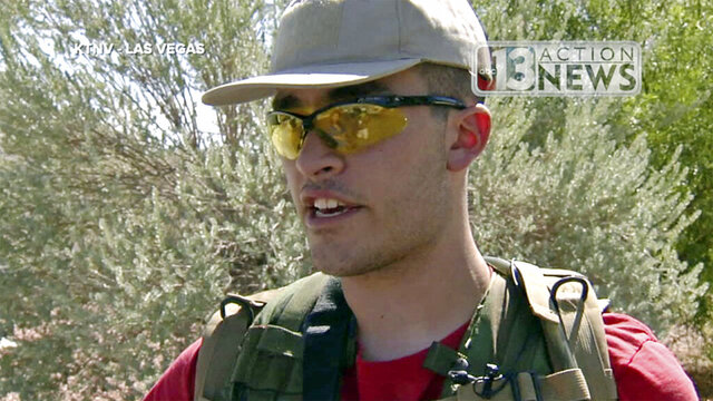 FILE - This Sept. 22, 2016, file photo taken from video from KTNV 13 Action News shows Conor Climo during an interview while walking a Las Vegas neighborhood, heavily armed.  Climo, a white supremacist who told an undercover FBI agent about his plans to firebomb a synagogue or attack a Las Vegas bar catering to LGBTQ customers has been sentenced to two years in prison.   Climo apologized before U.S. District Judge James Mahan sentenced him Friday, Nov. 13, 2020,  to prison followed by six months of home confinement with electronic monitoring.    (KTNV 13 Action News via AP, File)