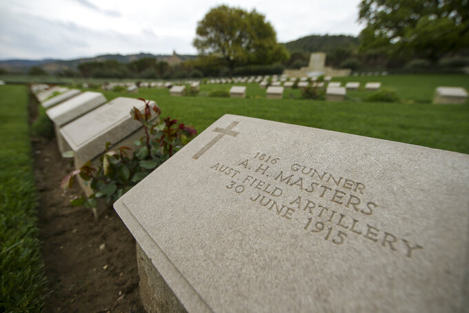A view of Anzac Cove cemetery, on the site of the World War I landing of the ANZACs (Australian and New Zealand Army Corps) in Canakkale, Turkey, Saturday, April 24, 2021, a day ahead of the 106th anniversary of the Gallipoli Campaign. The Gallipoli Campaign of 1915 by Allied forces aimed to take control of the peninsula to weaken the Ottoman Empire. The campaign failed and Allied forces withdrew after eight months of fighting on the ground and some 250,000 casualties on both sides. The memorials were kept small due to the COVID-19 pandemic.(AP Photo/Emrah Gurel)