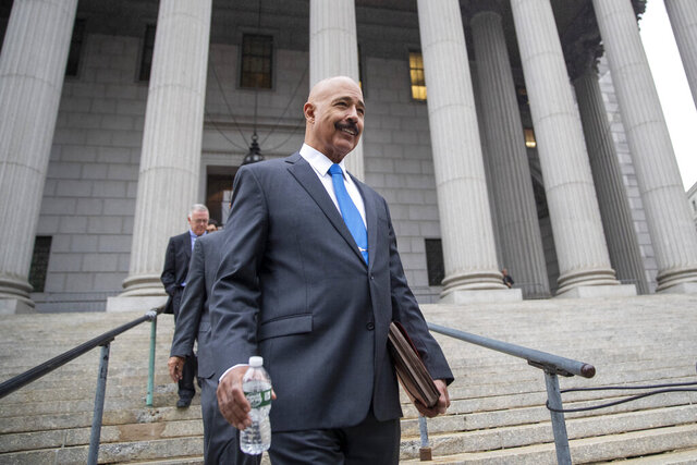 FILE - In this Oct. 22, 2019, file photo, Ted Wells, Jr., the lead attorney for Exxon, leaves New York Supreme Court in New York, after opening arguments in a lawsuit against Exxon. Exxon Mobil prevailed Tuesday, Dec. 10, 2019, in a lawsuit accusing the energy giant of downplaying the toll that climate change regulations could take on its business, with a judge saying the state attorney general's case didn't prove the company deceived investors — but also didn't excuse it of any accountability for global warming (AP Photo/Mary Altaffer, File)