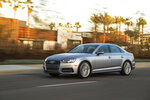 This photo provided by Audi shows the 2018 Audi A4, a luxury sedan that's available with a manual transmission. The Audi is engaging to drive, feels luxurious both inside and out, and has lots of available tech. (Jim Fetts/Courtesy Audi via AP)