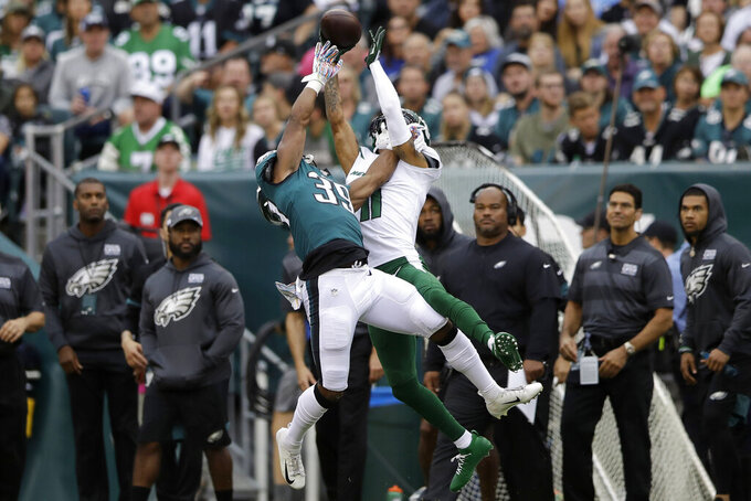 New York Jets' Robby Anderson, right, cannot catch a pass against Philadelphia Eagles' Craig James during the first half of an NFL football game, Sunday, Oct. 6, 2019, in Philadelphia. (AP Photo/Matt Rourke)