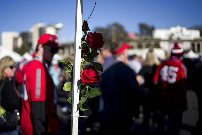 Fans arrive before the Rose Bowl NCAA college football game between Ohio State and Washington Tuesday, Jan. 1, 2019, in Pasadena, Calif. (AP Photo/Jae C. Hong)
