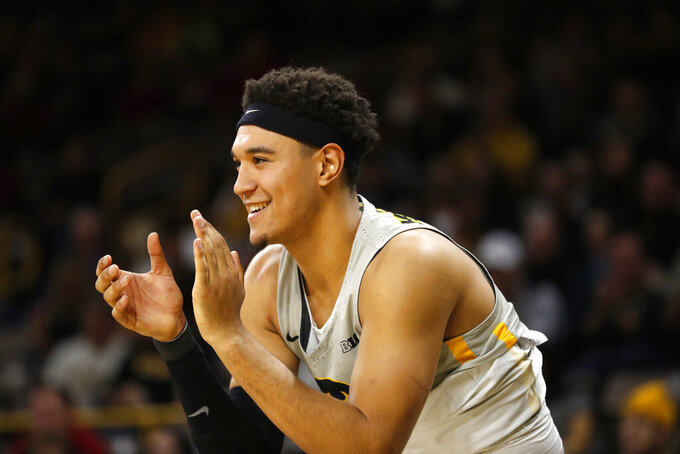 FILE - In this Dec. 6, 2018, file photo, Iowa forward Cordell Pemsl celebrates during the second half of an NCAA college basketball game in Iowa City, Iowa. Pemsl has been arrested for suspected drunken driving and suspended from the team. The Hawkeyes say in news release that the team suspended Pemsl indefinitely following his arrest early Friday Sept. 20, 2019. (AP Photo/Charlie Neibergall File)