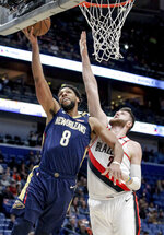 New Orleans Pelicans center Jahlil Okafor (8) scores over Portland Trail Blazers center Jusuf Nurkic (27) in the first half of an NBA basketball game in New Orleans, Friday, March 15, 2019. (AP Photo/Scott Threlkeld)