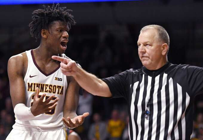 Minnesota's Daniel Oturu (25) reacts to a call after the ball went out of bounds during the second half of the team's NCAA college basketball game against Maryland on Wednesday, Feb. 26, 2020, in Minneapolis. Maryland won 74-73. (AP Photo/Hannah Foslien)