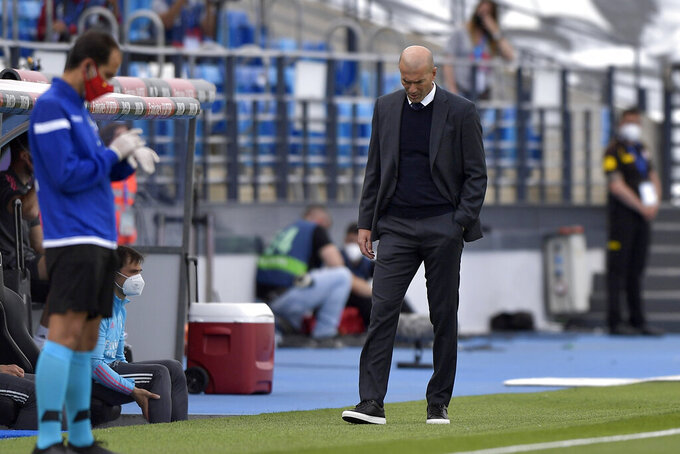 Real Madrid's head coach Zinedine Zidane walks by the touchline during the Spanish La Liga last round soccer match between Real Madrid and Villarreal at the Alfredo Di Stefano stadium in Madrid, Saturday, May 22, 2021. (AP Photo/Pablo Morano)
