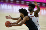 Southern California forward Chevez Goodwin, right, defends against Oregon State guard Ethan Thompson during the first half of an NCAA college basketball game Thursday, Jan. 28, 2021, in Los Angeles. (AP Photo/Ashley Landis)