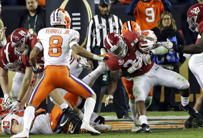 Alabama's Damien Harris is stopped near the goal line during the second half of the NCAA college football playoff championship game against Clemson, Monday, Jan. 7, 2019, in Santa Clara, Calif. (AP Photo/David J. Phillip)