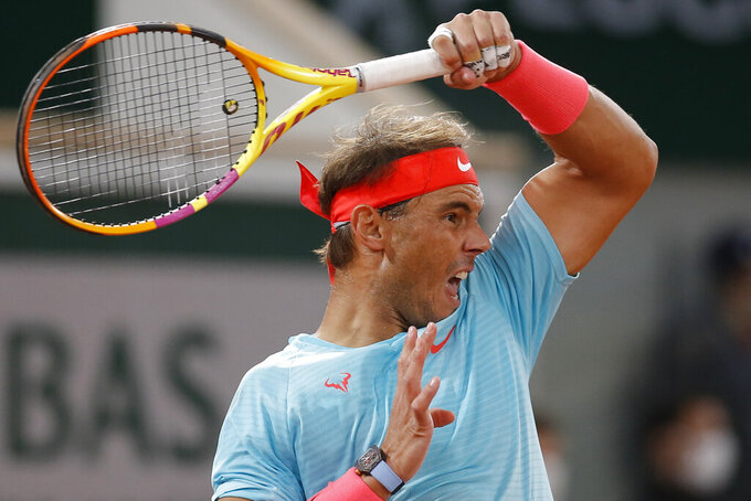 Spain's Rafael Nadal plays a shot against Serbia's Novak Djokovic in the final match of the French Open tennis tournament at the Roland Garros stadium in Paris, France, Sunday, Oct. 11, 2020. (AP Photo/Michel Euler)