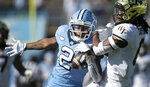 North Carolina's Dyami Brown (2) pulls in a 54-yard pass from quarterback Sam Howell against the defense of Wake Forest's Ja'Sir Taylor (6) in the first half Saturday, Nov. 14, 2020, in Chapel Hill, N.C. (Robert Willett/The News & Observer via AP, Pool)