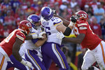 Kansas City Chiefs defensive end Emmanuel Ogbah, left, sacks Minnesota Vikings quarterback Kirk Cousins, second left, as Minnesota Vikings offensive guard Pat Elflein (65) blocks Kansas City Chiefs defensive tackle Chris Jones (95), in the first half of an NFL football game in Kansas City, Mo., Sunday, Nov. 3, 2019. (AP Photo/Reed Hoffmann)